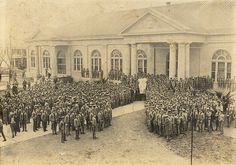 A & M Cadets gathered in front of Sbisa Dining Hall with the Rice Owl mascot costume in the early 1900's