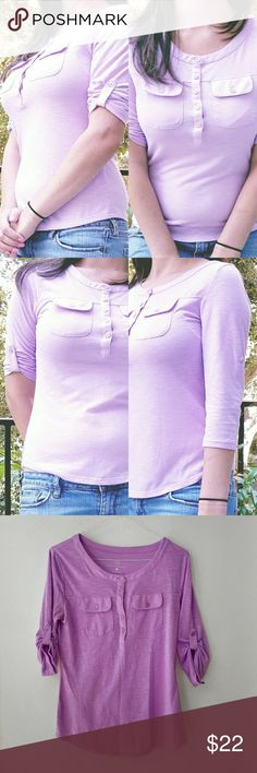 New York & Company light Purple Blouse New York & Company light Purple Blouse buttons up the neckline, Roll tab sleevess and modern high/low hem 2 pockets on the front. 70% Polyester 30% Rayon, Bust 26 inches,waist 26 inches.  24 inches long. New York & Company Tops Blouses