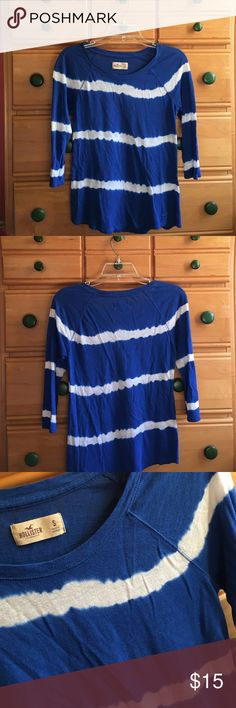"""Hollister Striped 3/4 Sleeve 💥make me an offer!💥                                                   a little wrinkly in the pics from it being folded all up for a while but a cute Hollister 3/4 sleeve! the white stripes sorta bleed into the blue giving it a subtle """"acidic"""" look. gently used & no flaws :-) Hollister Tops Tees - Long Sleeve"""