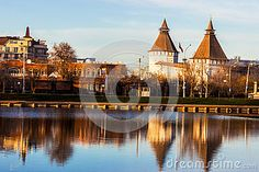 Astrakhan Kremlin and Iranian Embassy, Russia, Swan lake city pond. March 2015