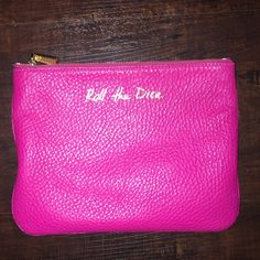 'Roll the Dice' pink pouch REBECCA MINKOFF 9x7 inches , square pouch hot pink leather with bright gold lettering 'roll the dice' , gold zipper, zipper works perfectthis would be in stellar condition, however a can of mineral makeup got loose & spilled all over the interior of here(see photo of inside) so the inside is foggy with that. I'm sure it could be cleaner Better but I didn't take it anywhere! So beautiful & a rare beauty! Rebecca Minkoff Bags Cosmetic Bags & Cases
