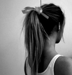 "hair | ponytail + bow     Maybe because of the ""undone"" look of the ponytail the ribbon bow is cute, but not overly girly."