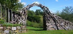 log wall and coffee root archway Artists sculpture garden open for charity
