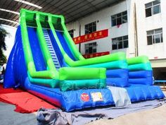 blue and green giant inflatable slide with two lanes. Inflatable Slide, Giant Inflatable, Outdoor Chairs, Outdoor Furniture, Outdoor Decor, Decks, Blue Green, Home Decor, Duck Egg Blue
