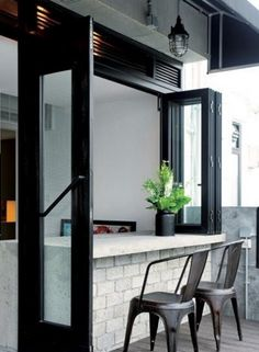 a black framed foldable window and an outdoor breakfast zone or pass-through bar