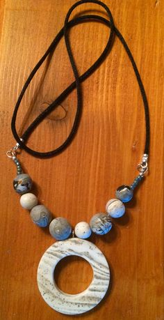 """River Rock."" Polymer clay beads and pendant, with a few seed beads added for embellishment."