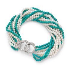 TURQUOISE, PEARL AND DIAMOND NECKLACE / TORSADE WITH BRACELET. Clasp in white gold 750. Decorative necklace with 4 strings of small turquoise beads of ca. 3 mm Ø, and 7 strings of cultured pearls of ca. 3 mm Ø. Clasp set with diamonds, weighing ca. 0.20 ct. L ca. 38 cm. Matching bracelet with 5 strings of turquoise beads and 7 strings of pearls. Clasp set with diamonds weighing ca. 0.20 ct. L ca. 19 cm. Estimation 1.500 CHF