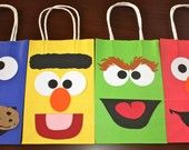 Sesame Street character goodie bags - REALLY easily made at home. All you would need to buy would be the primary colour paper bags - everything else can be cut out and pasted at home!