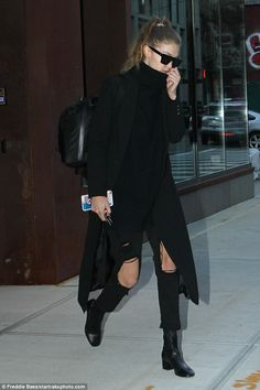 Not again:Covering up with a black coat that reached below her knees, the model made sure to keep THIS coat off the dirty New York ground