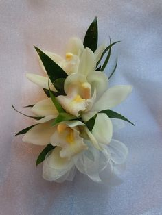 Pin on Corsage for Mothers -Mini white cymbidium orchids Prom Flowers, Bridal Flowers, Beautiful Flowers, Prom Corsage And Boutonniere, Corsage Wedding, Boutonnieres, Orchid Corsages, Flower Corsage, Wrist Corsage