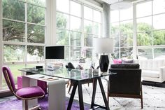The 360 Office Turnaround - Heidi used the vintage pillows as the overall color palette and focused on bringing in color in doses that felt right, not overwhelming. The work space is the brightest with the pink chair, purple rug and pink filing cabinet but, because everything else is pretty quiet, it works. by Homepolish San Francisco https://www.homepolish.com/mag/The-360-Office-Turnaround?gallerize=feeaf57f