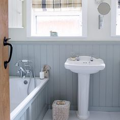 Compact bathroom with blue wall panelling | Small bathroom design ideas | Decorating | housetohome.co.uk