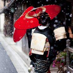A Geisha in snowy Kyoto, Japan