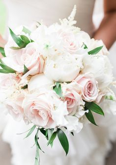 Brides LOVE roses and peonies - and when they look this good we're not surprised! We are loving Ella and Max's real wedding with a Maggie Sottero gown, pink bridesmaid dresses, vintage pink roses and ivory peonies and a classic white and gold reception decor colour scheme! See more  on the Wedding Ideas website!