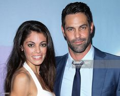 Actors Lindsay Hartley (L) and Jason-Shane Scott (R) attend the 'Save Our Sea' charity event at the 'W' Hollywood on July 11, 2014 in Hollywood, California.