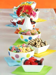 """Edible """"Beads"""". Present goodies in cute bowls down the center of a table and let kids string the pieces one by one to make their own edible necklace or bracelet. Use fruit flavored round toasted cereal, hard mint candies, hard or chewy fruit candies, or mini cookies with holes."""