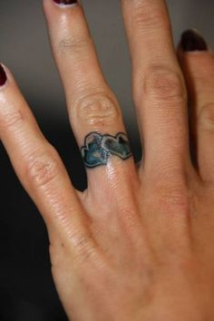 Ring fingers tattoo designs wedding ring tattoo ideas for Finger tattoo care instructions