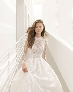 Princess-style lace wedding dress with long sleeves, bateau neckline, V-back and sheer inserts. 2018 Rosa Clará Couture Collection.