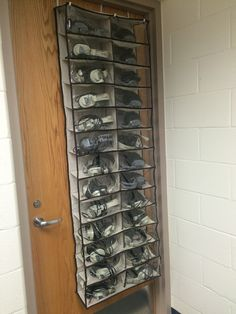 An over the door shoe organizer works great for organizing the classroom's headphones. No more tangles!