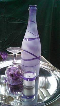 Painted wine bottle (wrap rubber bands around wine bottle and spray paint, paint inside of bottle).