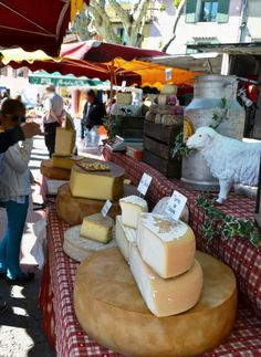Cheese stall  -- Provence market photo from Cooking in Provence