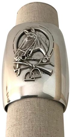 """Ultra Rare Huge Ralph Lauren Sterling Silver Equestrian Cuff Bracelet. This extraordinarily rare and beautiful cuff will turn heads whenever you wear it. It features a magnificent horse's head, framed with a large horseshoe, as well as a pair of stirrups and riding crop. It measures approximately 3 3/8"""" wide. It should fit most wrists as it has a wide opening and has flexibility. Engraved signature. This is a RARE GEM indeed.  