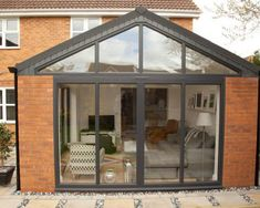 Bi-fold doors in Hampshire add a contemporary feel to orangeries and conservatories. View our aluminium Bi-Fold Door range and get a FREE quote. Bungalow Extensions, Garden Room Extensions, House Extensions, Orangerie Extension, Conservatory Extension, House Extension Plans, House Extension Design, Extension Ideas, Garage Extension