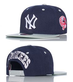 AMERICAN NEEDLE INC Baseball snapback cap Contrasting colors Embroidered Yankees logo stitching on the front of hat Adjustable strap for maximum comfort