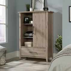Incorporate a beautiful appeal instantly to a variety of room setting with the selection of this wonderful SAUDER Summit Station Laurel Oak Armoire. Storage Spaces, Wardrobe Cabinets, Furniture, Storage Center, Tall Cabinet Storage, Home, Storage, Adjustable Shelving, Furniture Hardware