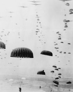 101st Airborne Division jumps near Eindhoven, Holland, September 17, 1944. Elements of the 506th Parachute Infantry Regiment are in the foreground.
