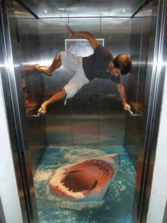 """Great White Shark Attack"" 3D art created on elevator floor by Robert Smith. I would never go in that elevator....ever....i would be that guy....and im not athletic....but that would still happen"