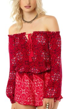 Loving this bold bandana print that adds Americana charm to an off-the-shoulder romper. It's also made with a blouson silhouette and flirty tassel ties.
