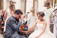 The groom moved by his bride serenading him at their musical wedding ceremony.