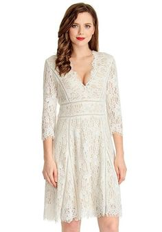 What's New // Looking for classic dress to wear to a special occasion? This white lace overlay plunge dress is what you are looking for.