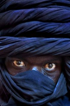 Africa | A Tuareg man waits for his camels to be given water in Timbuktu/Tomboctou in Northern Mali | ©Wendell Phillips