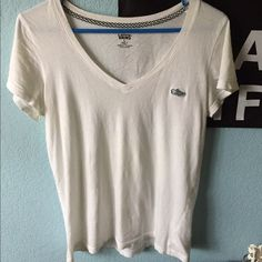 Vans V-neck White V neck from Vans of the Wall. Perfect condition, never worn. Has patch on chest with slip on checkerboard shoe. Vans Tops Tees - Short Sleeve