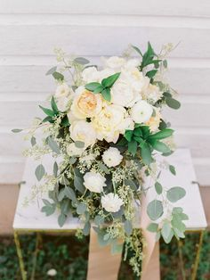 Lush wedding bouquet idea - overflowing wedding bouquet with ivory + white roses, dahlias, peonies and eucalyptus {Abraham Rowe Photography}