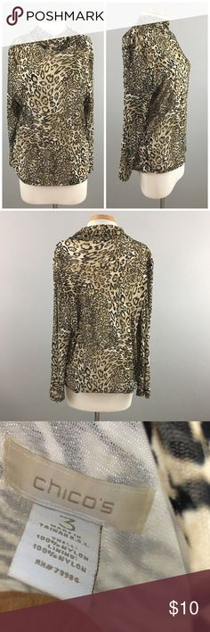 "Chico's Cheetah Print Stretch Turtle Neck Blouse Chico's Cheetah Print Stretch Turtle Neck Blouse. Size 3 (vanity sizing) XL. Blouse is lined and has lots of stretch. Thank you for looking at my listing. Please feel free to comment with any questions (no trades/modeling).  •Fabric: 100% Nylon  •Bust: 50""  •Length: 29""  •Condition:  VGUC, no visible flaws.   25% off all Bundles or 3+ items! Reasonable offers welcome. KC Chico's Tops Blouses"