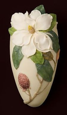 So, it isn't blue or green. It's still awesome. Magnolia Wall Vase/Wall Pocket