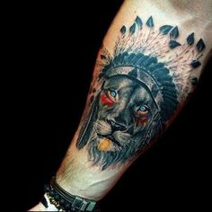 Awesome tattoos could be made based on the catch Native American themes. Here, the hand is printed with exquisitely feathered headgear and the face of the chief, in fact, a lion kin with lush growth of hair and sparkling eyes.
