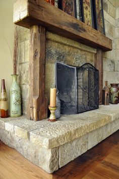 I like how they framed in this fireplace using the reclaimed wood beams. Notice the ends have some additional character that makes the mantle very interesting. Like this alot.