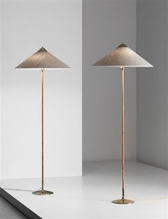 Paavo Tynell; #6902 Painted Metal, Brass and Leather Floor Lamps for Taito Oy, 1950s.