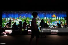 Visitors take park in an interactive digital installation , titled 'Sketch Town', during the Future World Exhibit at the ArtScience Museum, Marina Bay Sands on March 29, 2016 in Singapore. The ArtScience Museum collaborates with the award winning Tokyo based art collective, teamLab to present the Singapore largest digital playground permanent exhibition.