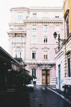 A cotton candy–hued building façade in Rome