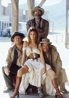 Raquel Welch flanked by Ernest Borgnine, Jack Elam and Strother Martin.