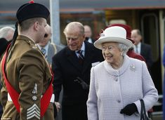 A warm welcome: The Queen is greeted by Pipe Major Ryan Anderson after arriving at Elgin Railway Station.