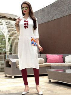 Grab this friendly snow white stitched simple kurta design for denim pant. This plain rayon top having sleeves & collared neckline is for working females. Simple Kurta Designs, Kurta Designs Women, Simple Kurtis, Valentine Gifts For Girls, Party Wear Kurtis, Long Kurtis, Designer Wear, Designer Kurtis, Indian Ethnic Wear