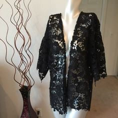 Black lace kimono crochet style with sleeves This is gorgeous. Its great over any outfit or even makes a great cover up over a swimsuit. It's material is very well made thicker. And it's crochet fabric is gorgeous.  Brand new without tag.  Sweaters Cardigans