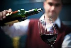 Image result for man pouring wine