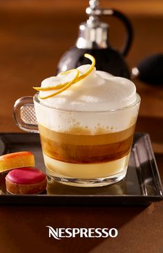 Dive into layers of indulgent flavor with this Cappuccino Fleur D'Oranger from Nespresso. This elegant coffee creation combines espresso, milk, and orange blossom water into one delicious recipe. Click here to learn more.